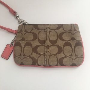 Coach brown signature with pink leather wristlet